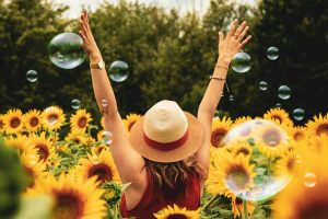 Woman-sunflowers-happy-the-beauty-of-now