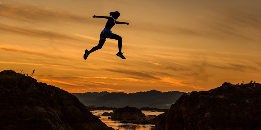 Woman-jumping-sunset-the-beauty-of-now