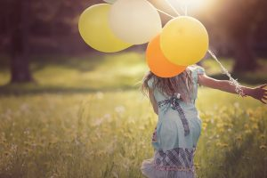 woman-running-balloons-sunshine-the-beauty-of-now