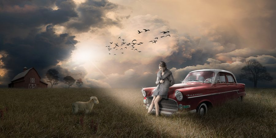 Procrastination-Light-Power-Mind-Woman Leaning against a car on a field-sun shines through the clouds-The-Beauty-Of-Now