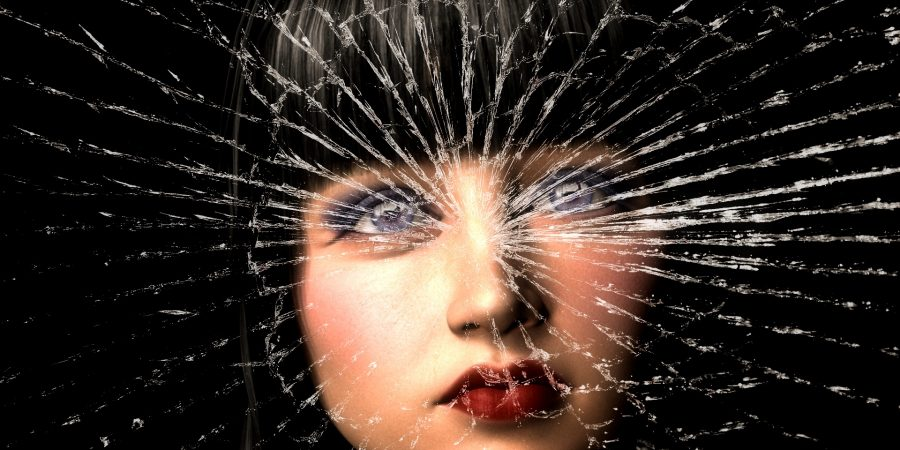 face of a woman overlaid with shattered glass-self-help-tool-destructive-the-beauty-of-now