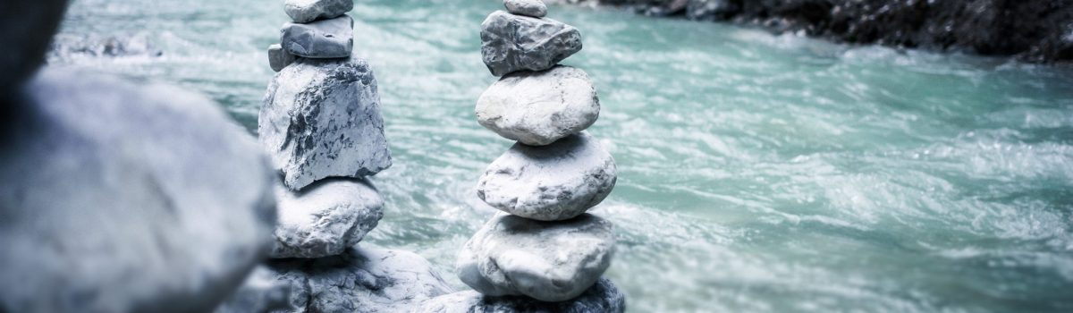 Pile of zen rocks, stream, water, Balanced-life-workshops-events-classes-the-beauty-of-now